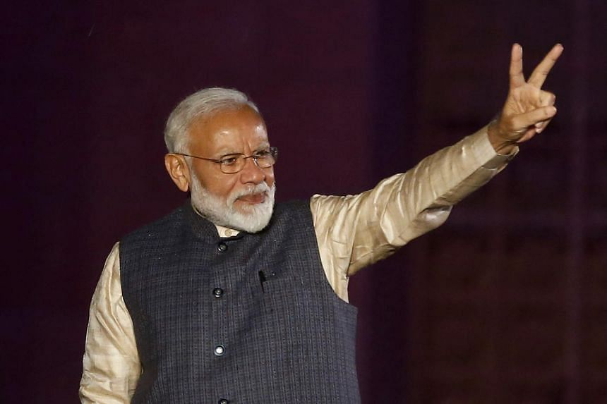 Indian Prime Minister Narendra Modi gestures towards his supporters after the election results at Bharatiya Janata Party headquarters in New Delhi, India, on May 23, 2019.