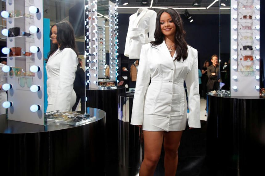 Pop superstar Rihanna poses in a pop-up store as she presents her first fashion collection for French luxury powerhouse LVMH.