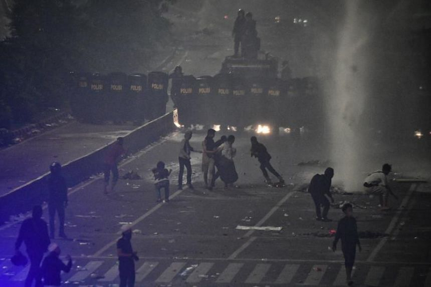Clashes have broken out between security forces and protesters this week after results showed Indonesian President Joko Widodo had defeated challenger Prabowo Subianto in last month's poll.