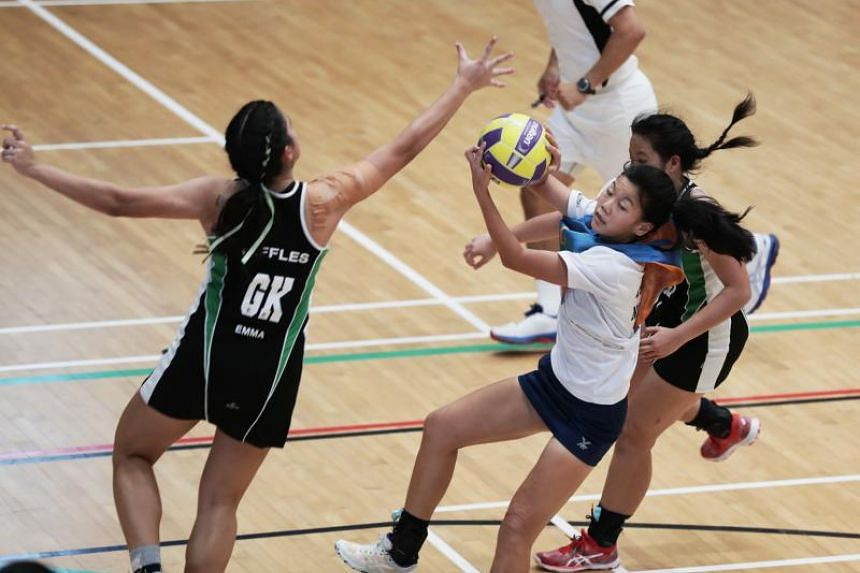 Anglo-Chinese Junior College captain Claudia Yip (centre) in action during the the A Division netball final against Raffles Institution on May 24, 2019.