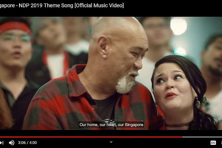 A YouTube screengrab of the National Day video, which also features singer-songwriter Mel Ferdinands and his daughter Gabrielle.