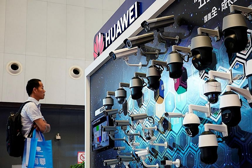Surveillance cameras at Huawei's booth at a security exhibition in Shanghai. The Trump administration is seeking to choke off Beijing's access to key technologies by limiting the sale of vital US components to the Chinese telecommunications equipment