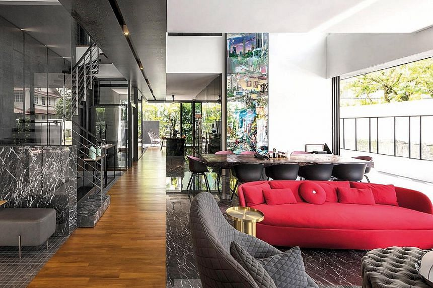 (Left) The master suite features fabric panels, Orobico marble, dark walnut and grey stone. (Above) Well-known furniture pieces dot the living room, such as the Bart Daybed by Bart Schilder and the Love Sofa High Back by Marcel Wanders, both for Mooo