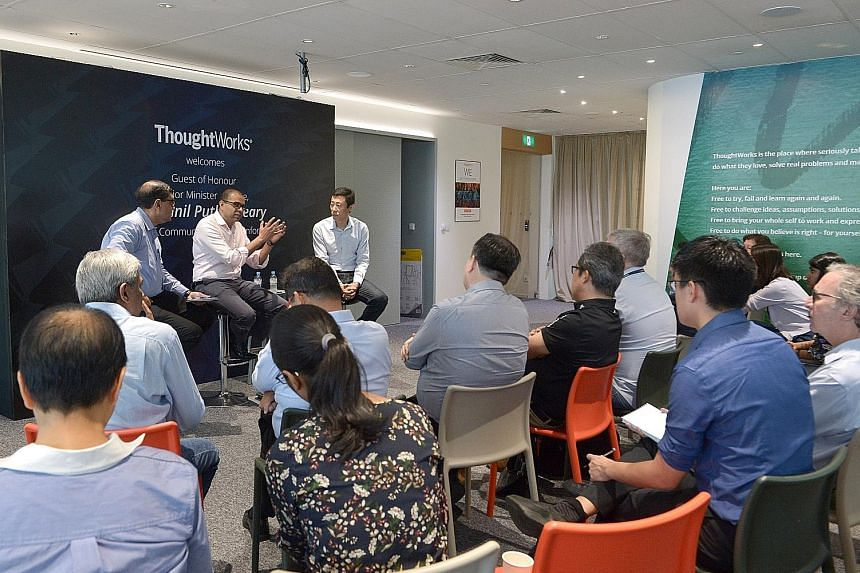 Senior Minister of State for Communications and Information Janil Puthucheary speaking at yesterday's dialogue, flanked by moderator Amit Roy Choudhury (left) and ThoughtWorks CEO Guo Xiao. Dr Janil cited various initiatives that demonstrate tech fir