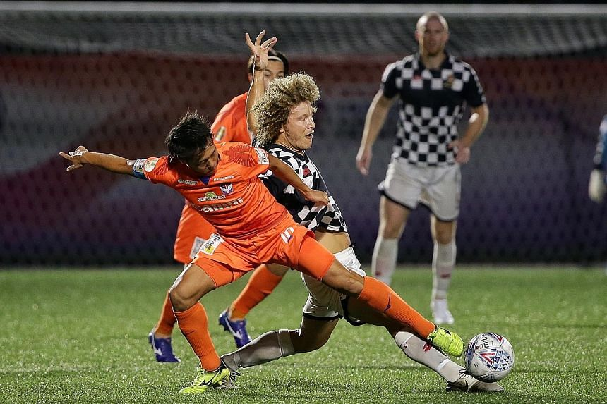 Albirex Niigata's Kyoga Nakamura (far left) had the better of the midfield battle against Brunei DPMM's Blake Ricciuto. But the Singapore Premier League champions were still held 0-0 at their Jurong East Stadium home. ST PHOTO: KEVIN LIM