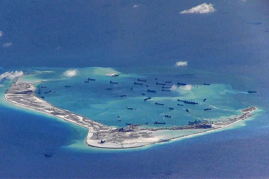 A still image from a US Navy video purportedly showing Chinese dredging vessels in the waters around Mischief Reef in the disputed Spratly Islands of the South China Sea. Besides China, the waterway is also claimed by Taiwan and several Asean countri