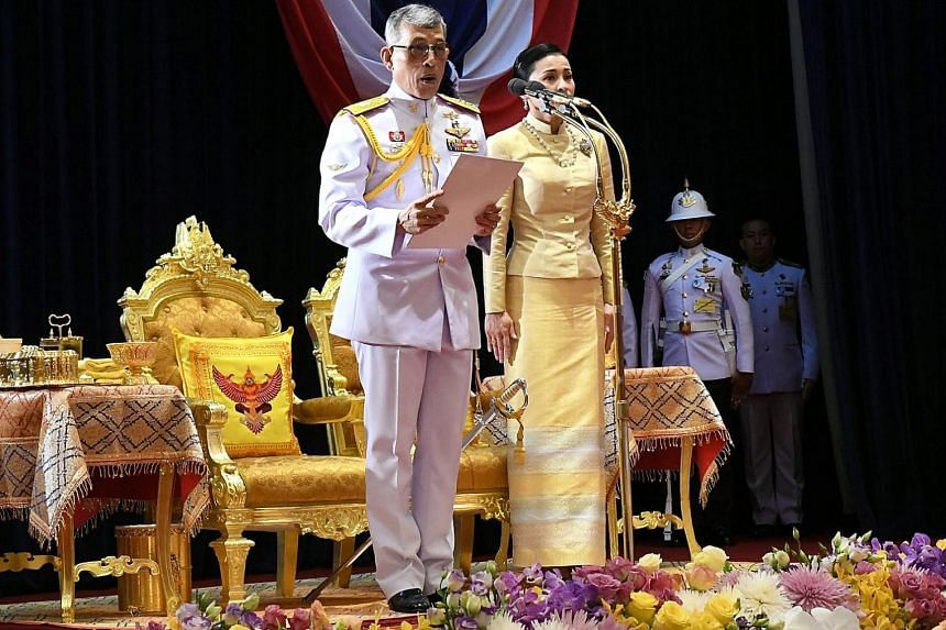 Thailand's King Maha Vajiralongkorn, accompanied by Queen Suthida, presiding over the opening of the first assembly of Parliament at the Ministry of Foreign Affairs in Bangkok yesterday. PHOTO: EPA-EFE