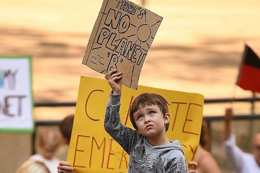 Young people in many countries including Germany (above) and Australia (left) turned out in force for the FridaysForFuture protest movement sparked by young Swedish climate campaigner Greta Thunberg. PHOTOS: EPA-EFE, DPA