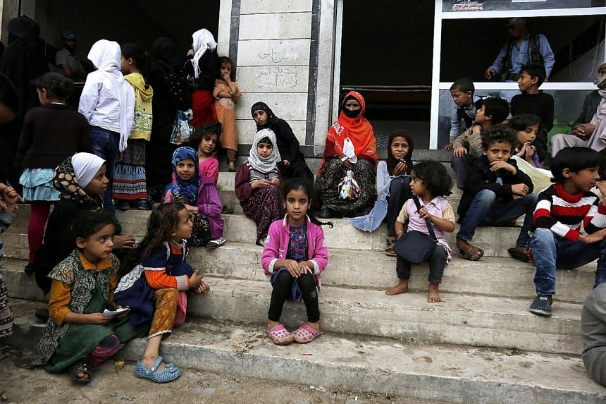Women and children waiting for food rations from a charity kitchen in Sana'a this month. A four-year conflict in Yemen has been deemed by the UN to be the world's worst humanitarian crisis, with thousands of civilians killed and millions suffering fr