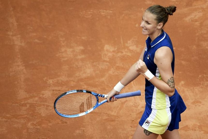 Czech Republic's Karolina Pliskova celebrates after winning against Britain's Johanna Konta during the WTA Masters tournament final tennis match at the Foro Italico camp in Rome, on May 19, 2019.