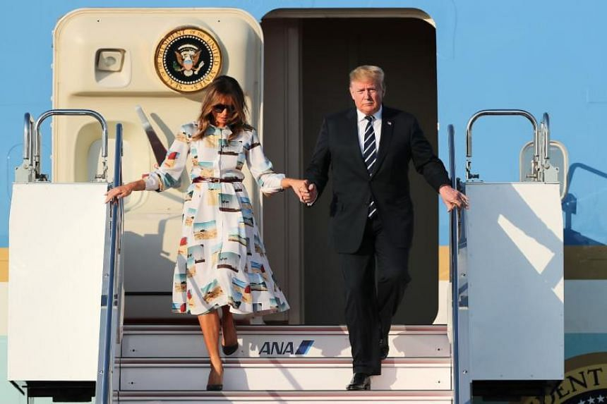 US President Donald Trump and First Lady Melania Trump arrive at Haneda international airport in Tokyo on May 25, 2019.