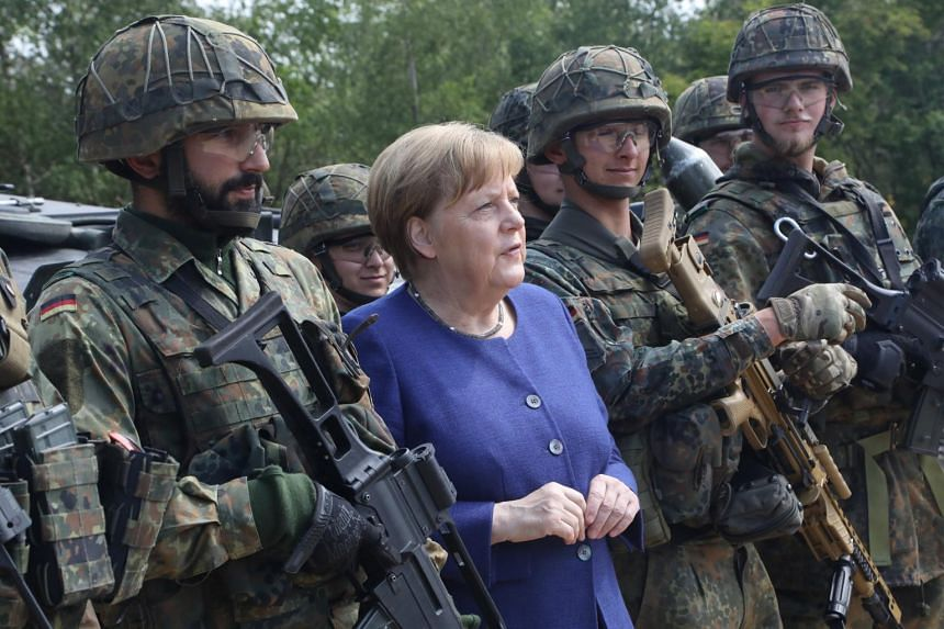 German Chancellor Angela Merkel with soldiers during her visit at the NATO Very High Readiness Task Force Land (VJTF L 2019) exercise in Muenster, Germany, on May 20, 2019.