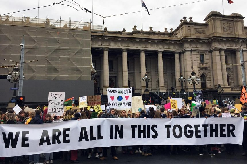 People at a rally led by Extinction Rebellion, call for action on climate change, in Melbourne, Australia, on May 24, 2019.