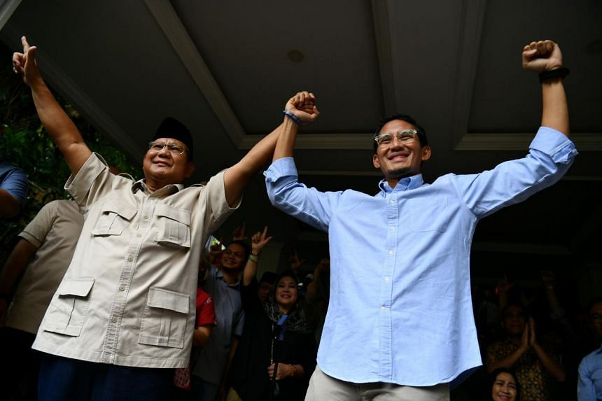 Indonesian presidential candidate Prabowo Subianto (left) and running mate Sandiaga Uno at a news conference after election results were announced in Jakarta on May 21, 2019.