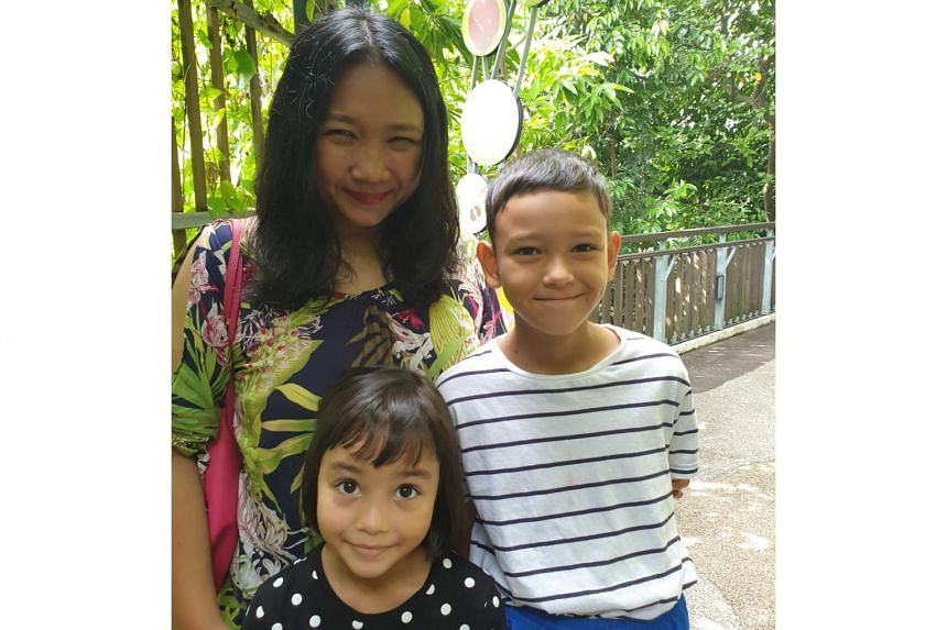 ST journalist Venessa Lee and her children, Micah Broom, 10, and Leah Broom, 6, on the Imbiah Trail on Sentosa.