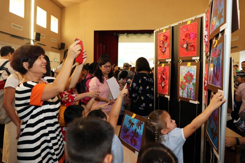 130 students from the Singapore Hokkien Huay Kuan Pre-school who helped to raise more than $10,000 for The Straits Times School Pocket Money Fund through sales of their artworks.