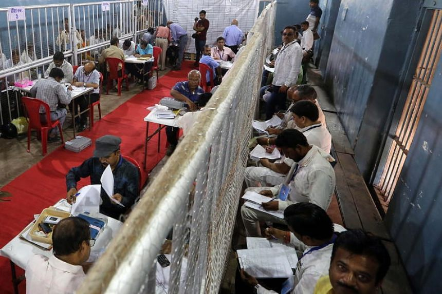 Election officials tally ballots for the Lok Sabha election in Bhopal, India, on May 23, 2019. Indian laws bar people from contesting an election if they have been convicted while in office for crimes that carry jail terms of two or more years.