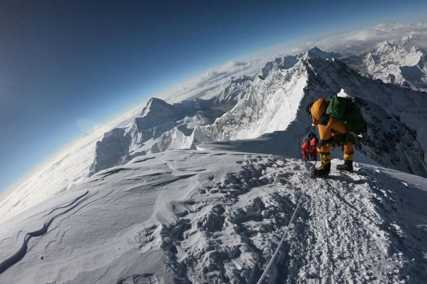 Mountaineers make their way to the summit of Mount Everest on May 17, 2018. The deaths of an Irish and a British climber on Mount Everest have taken the toll from a deadly week on the world's highest peak to 10.