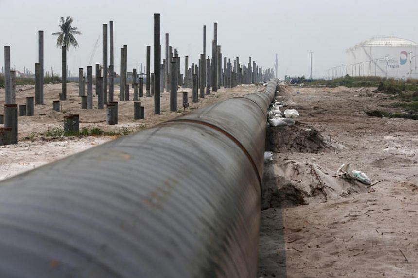 An oil pipeline in Johor. Malaysia is in discussions with China-based contractors for compensation relating to the termination of pipeline projects worth 9.4 billion ringgit (S$3.09 billion).
