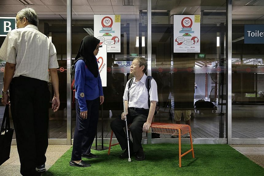 By the end of this year, all MRT stations will have priority queues for seniors, expectant mothers, wheelchair users and parents travelling with strollers. Major transport facilities will soon have signs in Braille and larger fonts. ST FILE PHOTO
