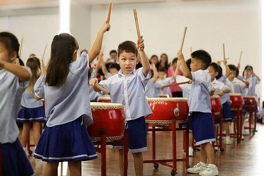 Pupils from Singapore Hokkien Huay Kuan Pre-school performing at its annual Dragon Boat Festival celebration yesterday.