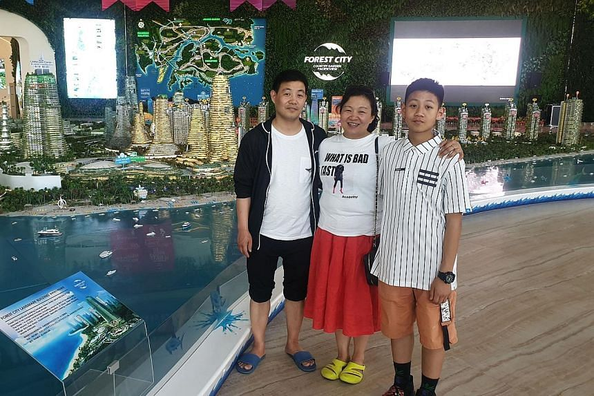 Johor resident Hanafi Mohamed Zin says entering Forest City is like entering China, with many shops selling Chinese goods. Chinese businesswoman Yang Ping visiting Forest City in Johor with her husband Chen Xu and their son Jim Chen earlier this mont