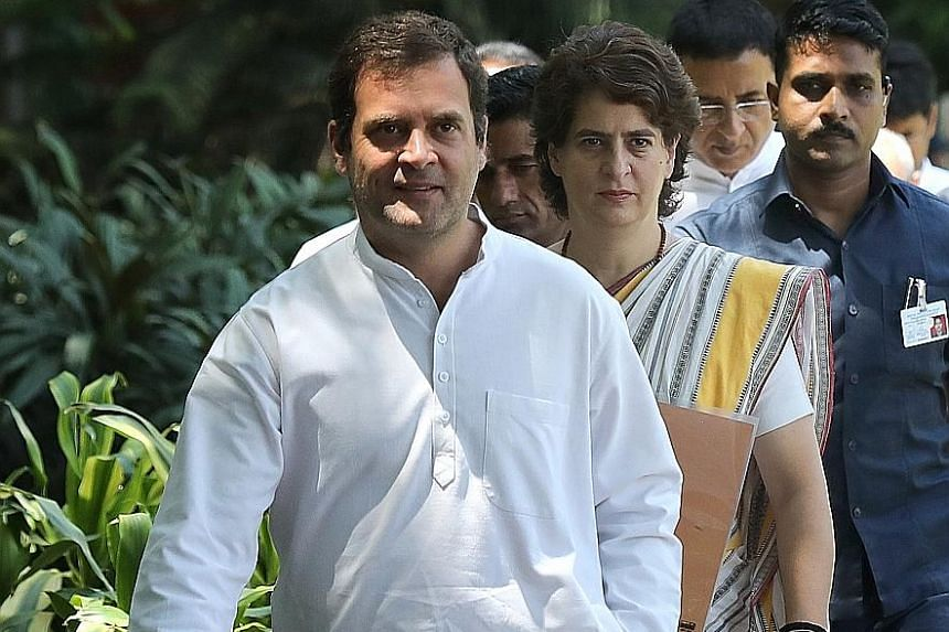 Congress party president Rahul Gandhi and his sister Priyanka arriving for yesterday's meeting at the opposition party's headquarters in New Delhi.