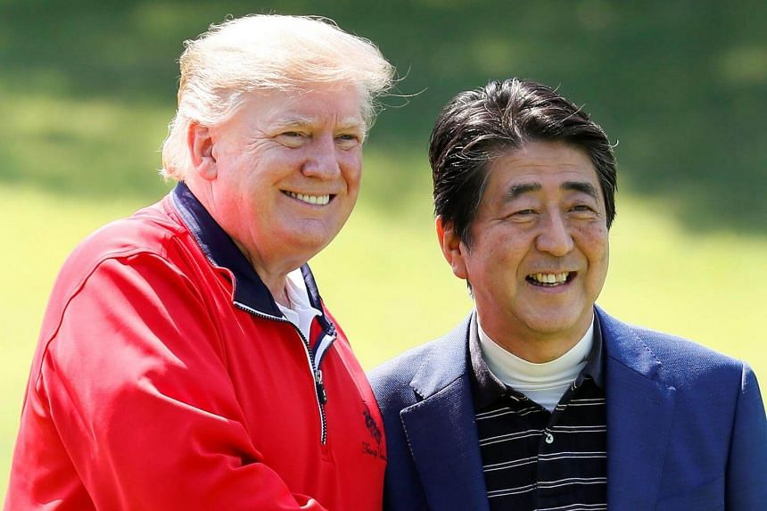 US President Donald Trump with Japan Prime Minister Shinzo Abe before playing a round of golf at Mobara Country Club in Chiba, on May 26, 2019.