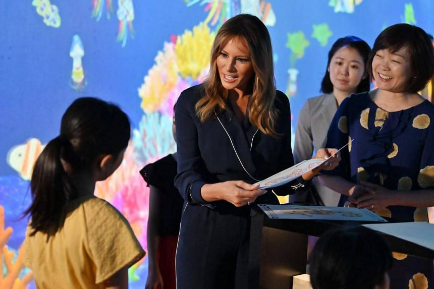 US First Lady Melania Trump meets children while visiting the Mori Building Digital Art Museum, flanked by Japanese Prime Minister Shinzo Abe's wife, Akie Abe (right) in Tokyo, on May 26, 2019.