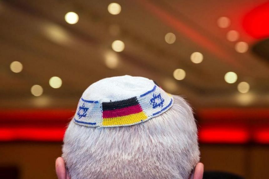 A man wearing a Jewish kippa skullcap with the flags of Germany and Israel on June 10, 2014 in Frankfurt am Main.