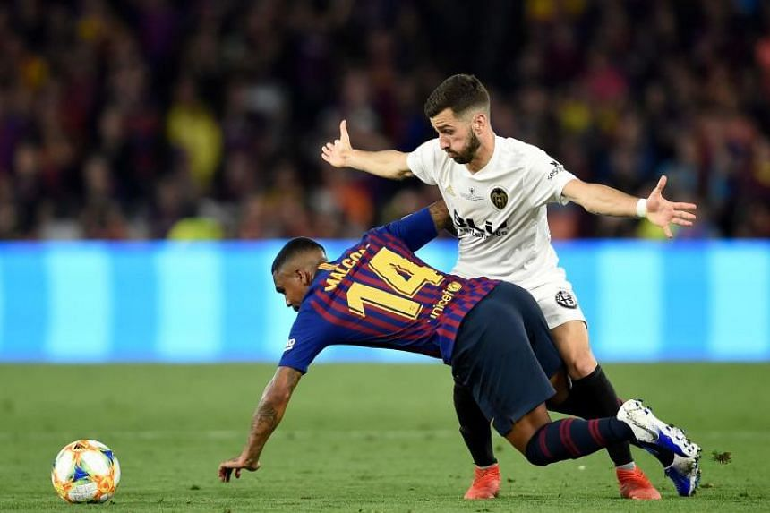 Valencia's Spanish defender Jose Luis Gaya Pena (right) challenges Barcelona's Brazilian midfielder Malcom during the 2019 Spanish Copa del Rey (King's Cup) final football match between Barcelona and Valencia at the Benito Villamarin stadium in Sevil