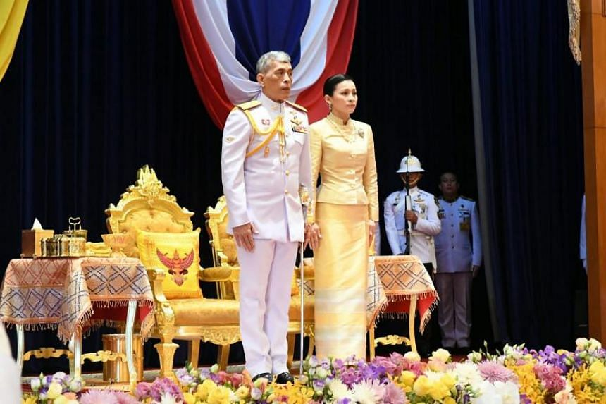 This handout from the Thai Parliament taken and released on May 24, 2019, shows Thailand's King Maha Vajiralongkorn and Thailand's Queen Suthida as he opens parliament in Bangkok.