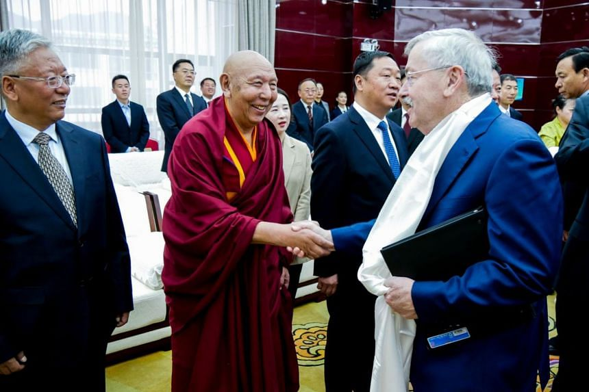 US Ambassador to China Terry Branstad (right) meeting local government and Communist Party leaders in Lhasa, in China's western Tibet Autonomous Region, on May 22, 2019.
