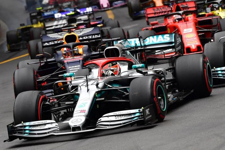 Mercedes' British driver Lewis Hamilton (left) drives ahead at the start of the Monaco Formula 1 Grand Prix at the Monaco street circuit on May 26, 2019.