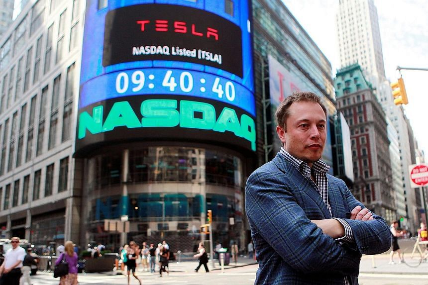Tesla CEO Elon Musk in a June 2010 photo after his company's IPO. Tesla reported a massive loss - its first earnings deficit - for the first three months of this year, along with a sharp drop in sales.