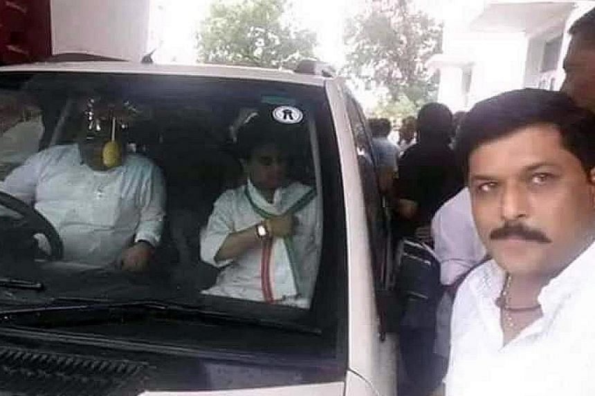 Dr Krishna Pal Yadav (right) of the Bharatiya Janata Party and Mr Jyotiraditya Scindia (in front passenger seat) of the Congress Party in a photo taken years ago by Dr Yadav when he was a Congress worker. PHOTO: @NIKHILANAND2007/TWITTER Senior Congre