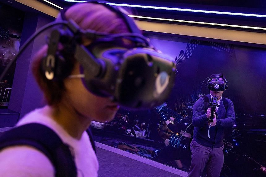 Video game players using virtual reality headsets in Seoul. The new WHO guidelines on gaming go into effect from January 2022. PHOTO: BLOOMBERG