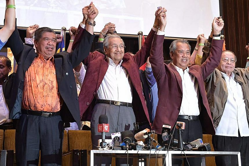 Prime Minister Mahathir Mohamad (second from left) at a press conference in Kuala Lumpur after Malaysia's general election in May last year. With him are (from left) Defence Minister Mohamad Sabu, Home Affairs Minister Muhyiddin Yassin and Democratic