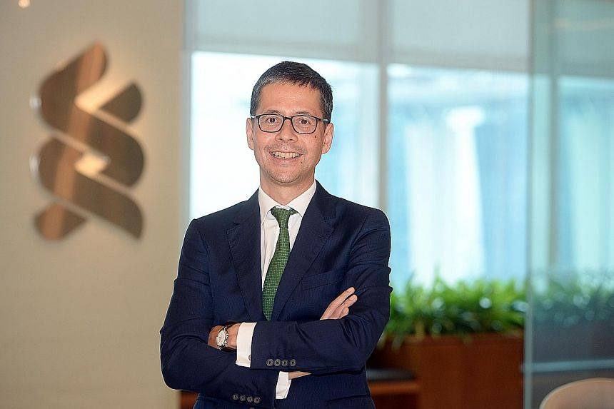 StanChart (Singapore) chief executive Patrick Lee says technology is a big driver for the lender to be more efficient.