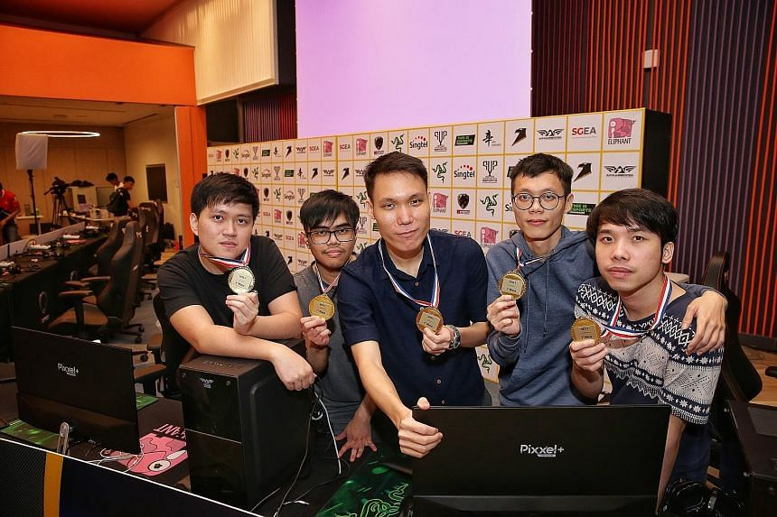 Team X's (from far left) Wilson Koh, Lukman Yusoff, Wong Jeng Yih, Teo Yao Wen and Joel Chan defeated Waacow Warriors 2-0 in the Dota 2 final at Singtel Recreation Club yesterday. They will be nominated by the Singapore E-sports Association for the S