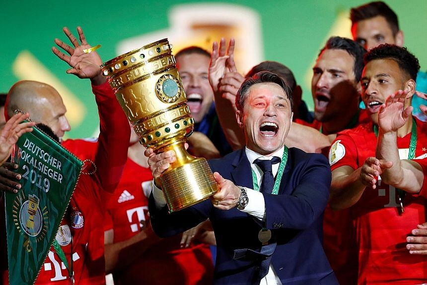 Bayern Munich coach Niko Kovac celebrating winning the German Cup with his players. There had been talk that he would be sacked even if the club did win the league and Cup double.