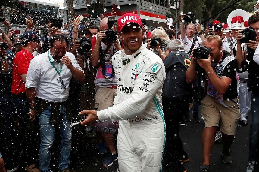 Lewis Hamilton is generous in spraying his winner's champagne after the Monaco Grand Prix. The Briton was struggling with his tyres, having fitted softer medium ones than his rivals. PHOTO: REUTERS