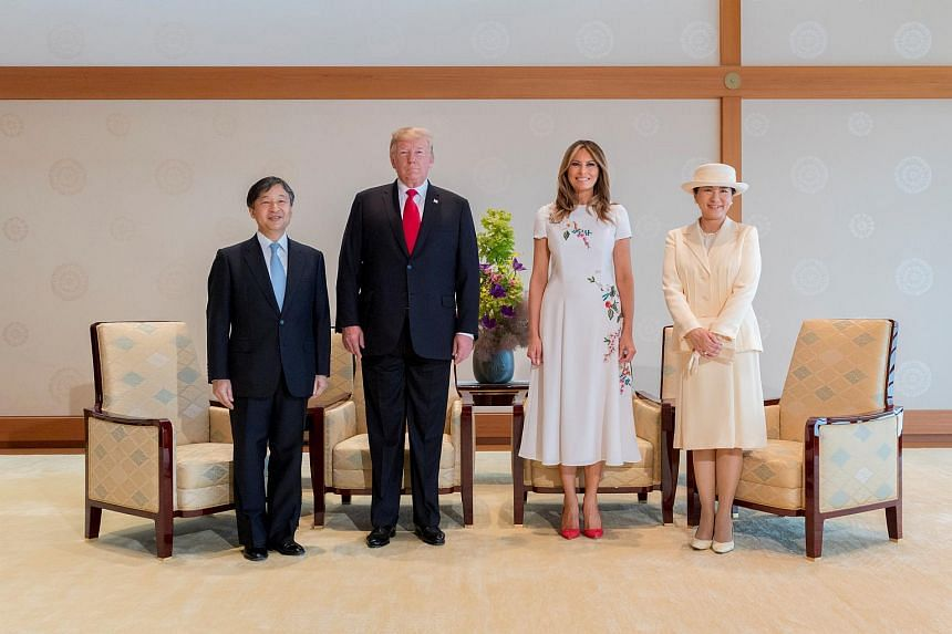 US President Donald Trump (second, left) and First Lady Melania Trump (second, right) with Japan's Emperor Naruhito (left) and Empress Masako (right) during their state call at the Imperial Palace in Tokyo, on May 27, 2019.