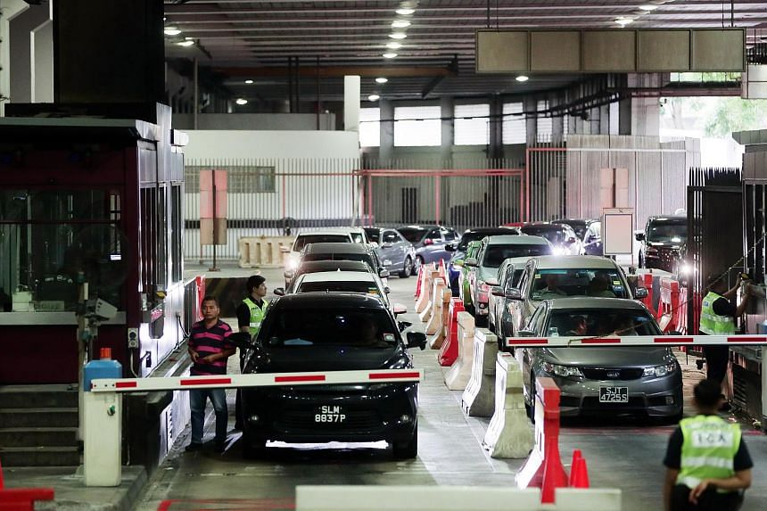 Vehicles queueing to clear customs at the Woodlands Checkpoint departure hall on April 12, 2019.