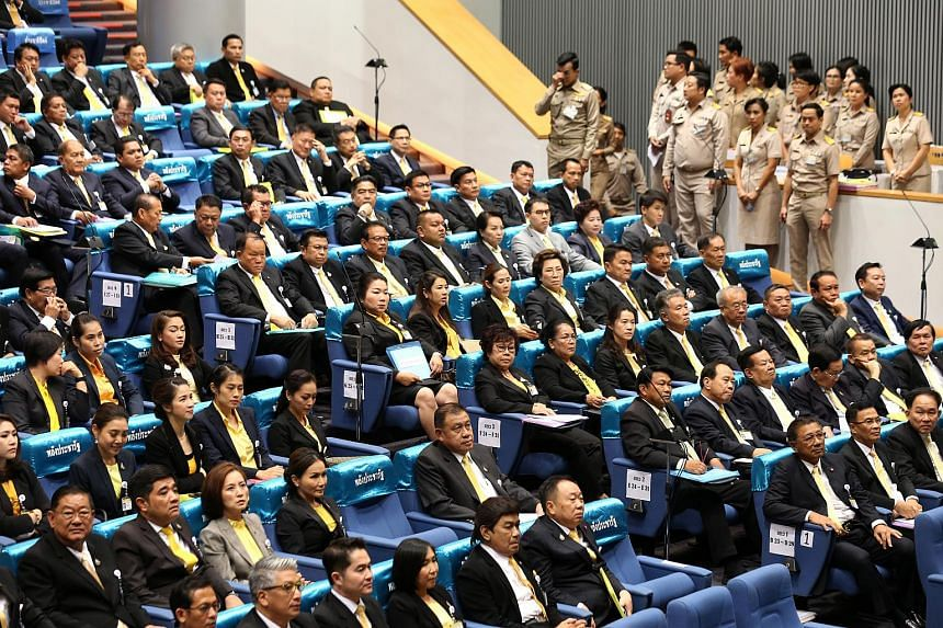 Members of Parliament who are part of the pro-junta political party Palang Pracharath join a meeting to vote for the new Speaker of the House of Representatives of Parliament, at the Telephone Organization of Thailand building, in Bangkok, on May 25,