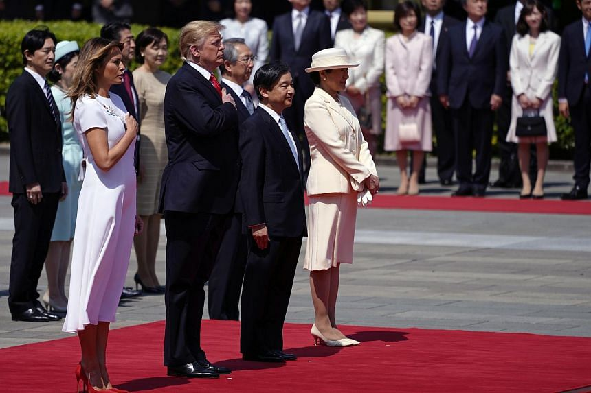 US President Donald Trump (second, left) and First Lady Melania Trump (left) attend a welcoming ceremony with Japan's Emperor Naruhito (second, right) and Empress Masako (right) at the Imperial Palace in Tokyo, on May 27, 2019.