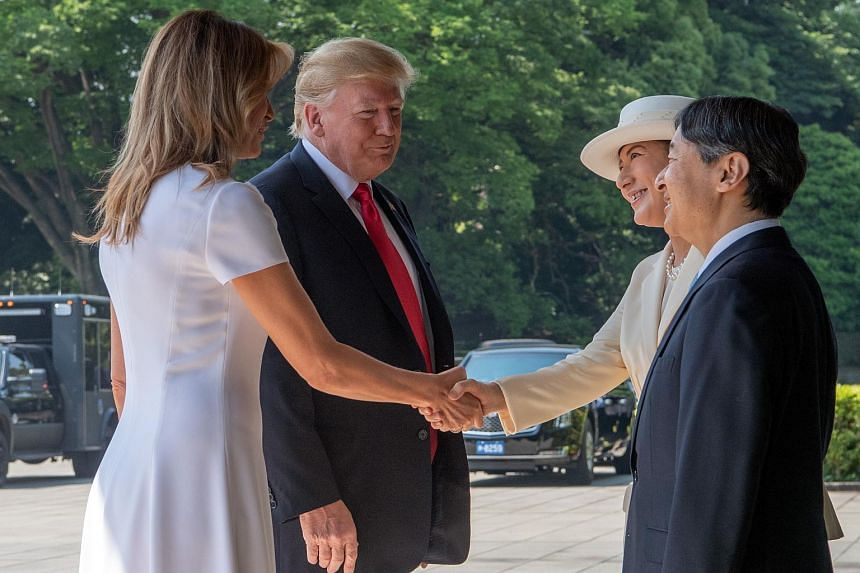 US First Lady Melania Trump (left) and US President Donald Trump (second, left) meet Japan Emperor Naruhito (right) and Empress Masako (second, right) during a welcome ceremony at the Imperial Palace in Tokyo on May 27, 2019.