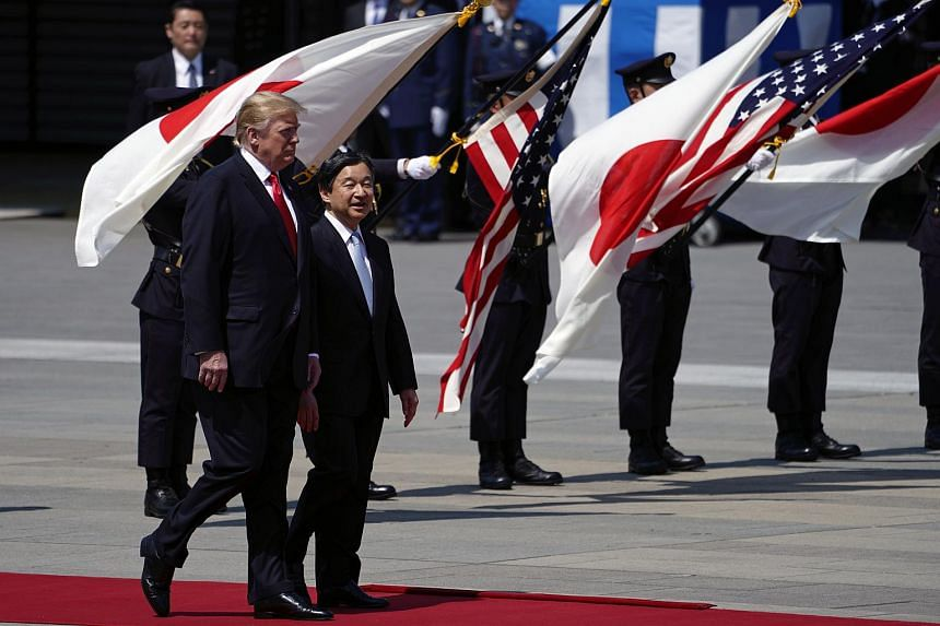 US President Donald Trump (left) being escorted by Japan's Emperor Naruhito during a welcoming ceremony at the Imperial Palace in Tokyo, Japan, on May 27, 2019.