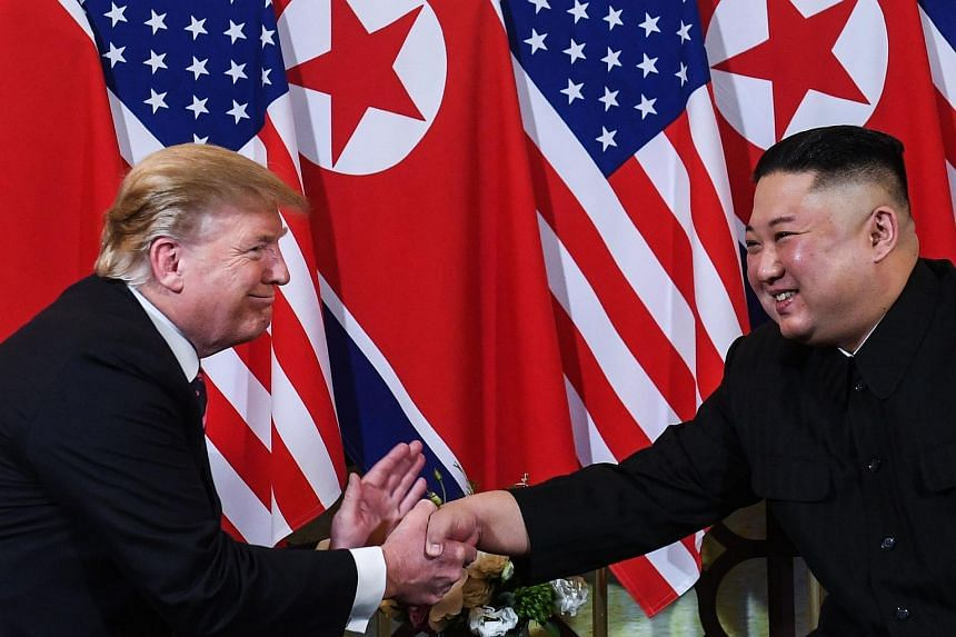 US President Donald Trump shaking hands with North Korean leader Kim Jong Un following a meeting in Hanoi on Feb 27, 2019.