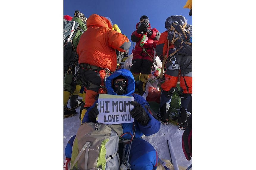 A photo provided by Tendi Sherpa of Ed Dohring on the top of Mount Everest on May 23, 2019, showing a crowd on the mountain.